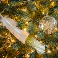 DIY gilded and glittered feather gift toppers... these would make cute christmas ornaments too!