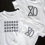 3 DIY XO Tshirts and Onesie made with black iron on vinyl