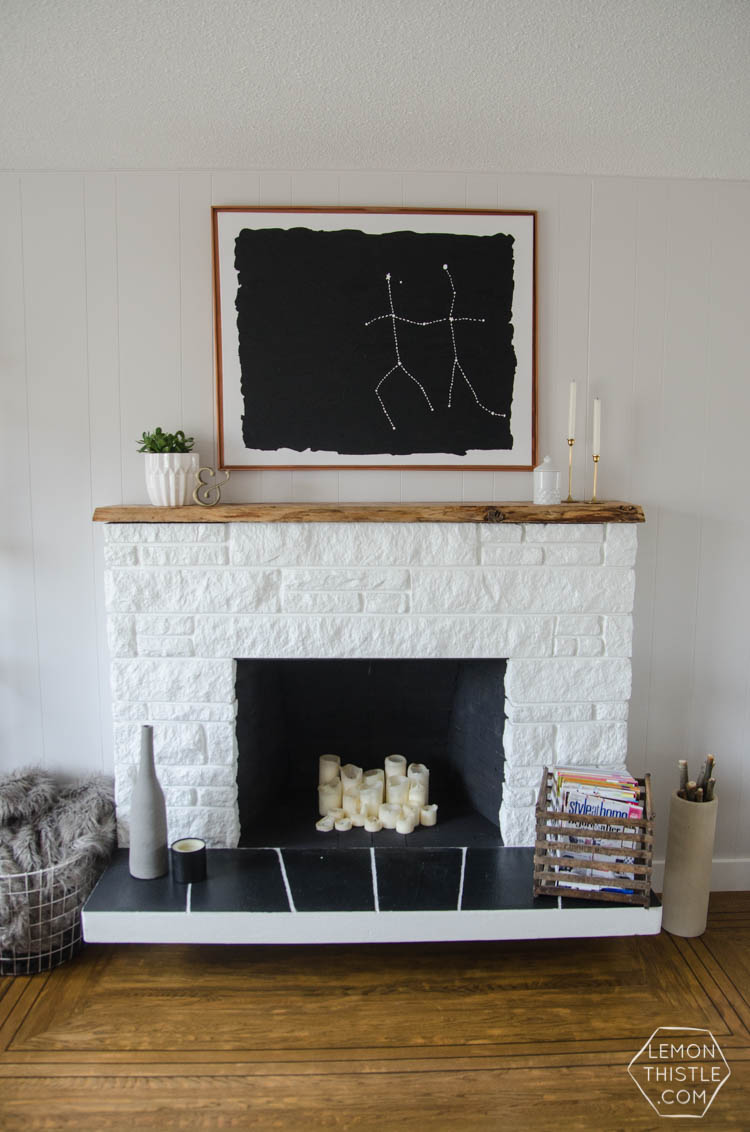 I painted my stone fireplace... and added a live edge mantle. Here's what I learned!