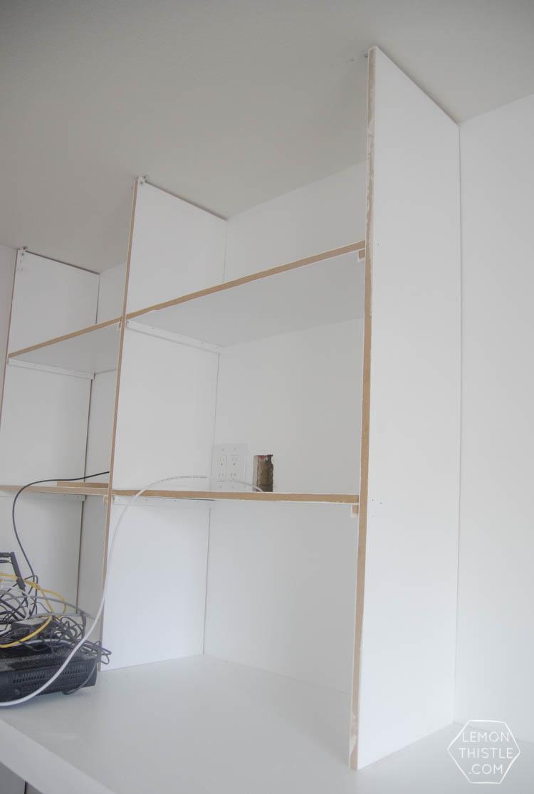 Assembly of custom built in shelving unit- click through for full tutorial
