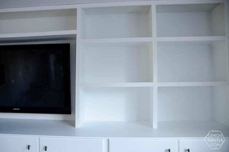 DIY built in cabinets for TV and storage- click through for full tutorial