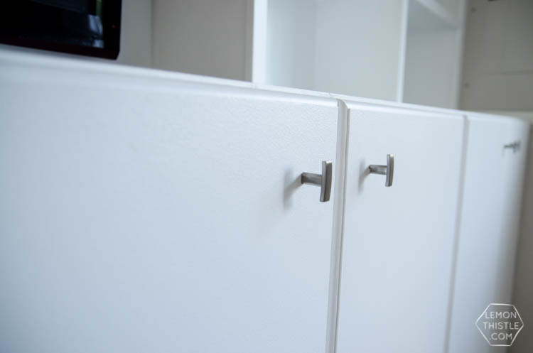 Assembly of built in cabinets for TV and storage- click through for full tutorial