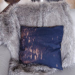 I love this pillow- such an easy DIY to spray navy fabric with bleach!