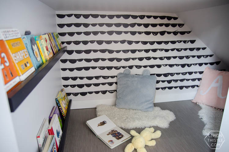An under stairs nook for kids to play! I love the hand stamped 'wallpaper'. Click through for full tutorial