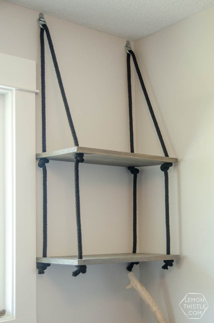 DIY Hanging Rope Shelving- such a fun alternative to a bookshelf!