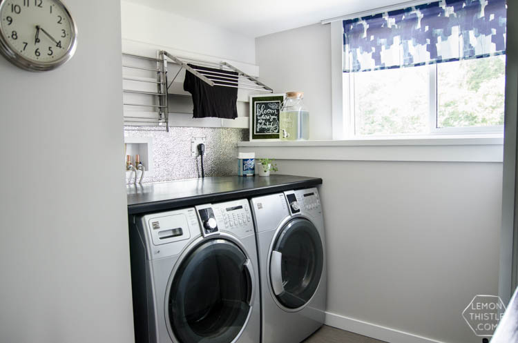 I love this laundry room makeover! I can't believe those countertops are WOOD!