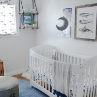 I love this updated take on a whale themed nursery with greys and blues... it could totally grow with them!