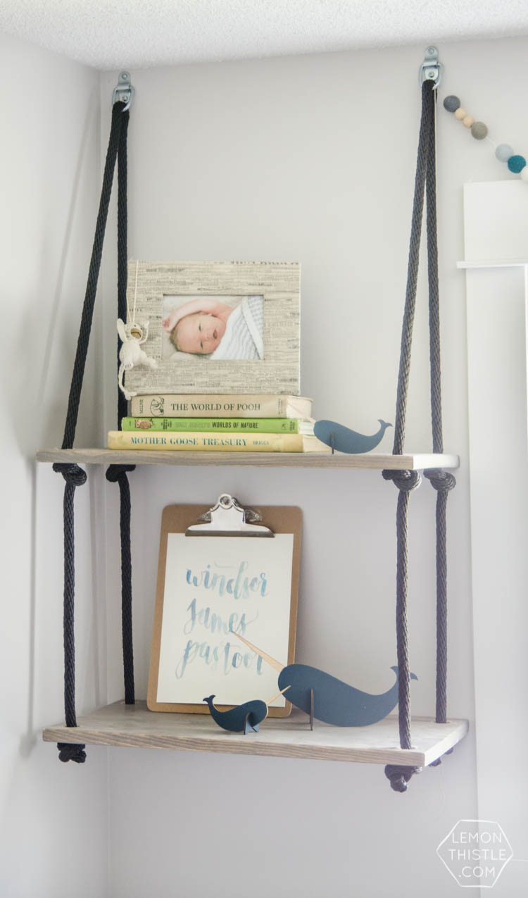 I love these hanging shelves for a nursery! Such a cool way to add storage and decor