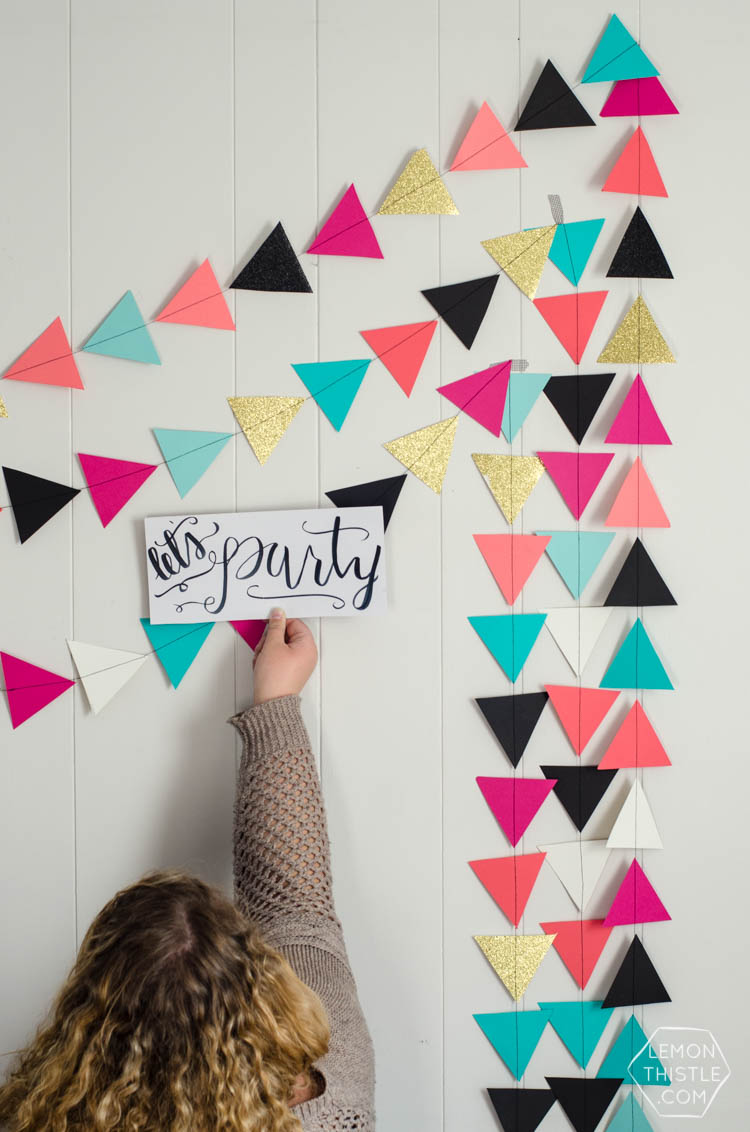 How to DIY a giant triangle garland... it's THAT garland! Finally, instructions I can manage- and I like the options to space out the triangles.