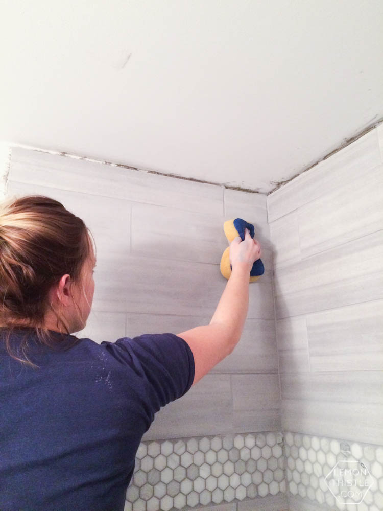 DIY Bathroom Renovation- I love that it breaks it down into stages! I've always wondered if I could renovate in phases. Everything is DIY too, from the tile to the shelf!