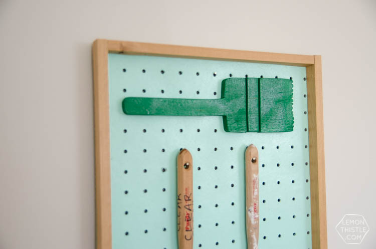 DIY Paintbrush storage board using pegboard- I love this idea! Plus the kids brushes are so smart