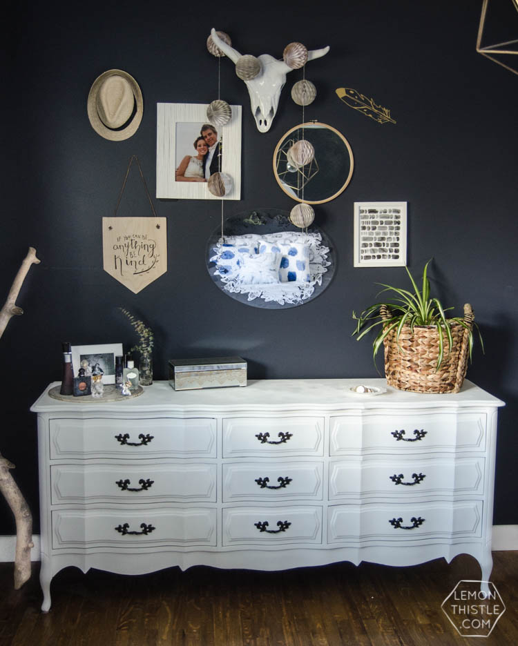 I LOVE this moody navy bedroom- the forrest, the gallery wall- the brass lights... it's all so good! And I love all the DIY