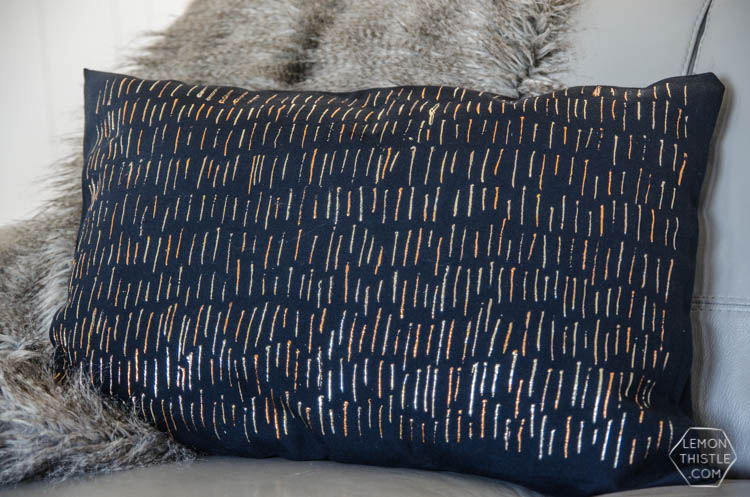 DIY No Sew Metallic Foil Throw Pillow- this is so shiny good! I can't believe it's washable.