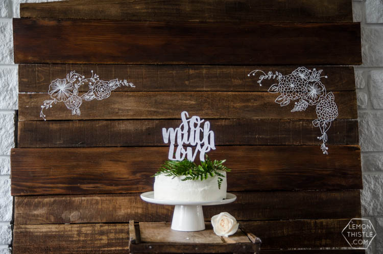 I LOVE this floral rustic backdrop- it's so perfect for a wedding or photo booth... it's so intricate, I can't believe it isn't drawn on there