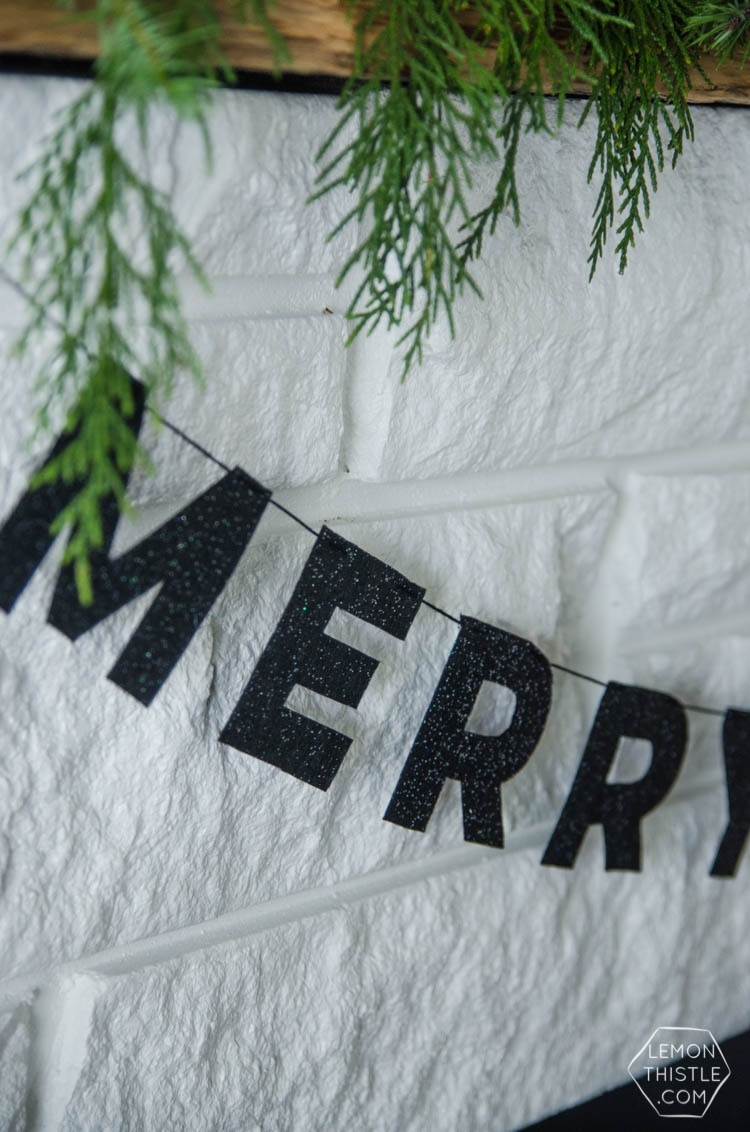 I love this DIY Christmas garland! The modern felt letters are perfect- and the pom pom is a cute detail!