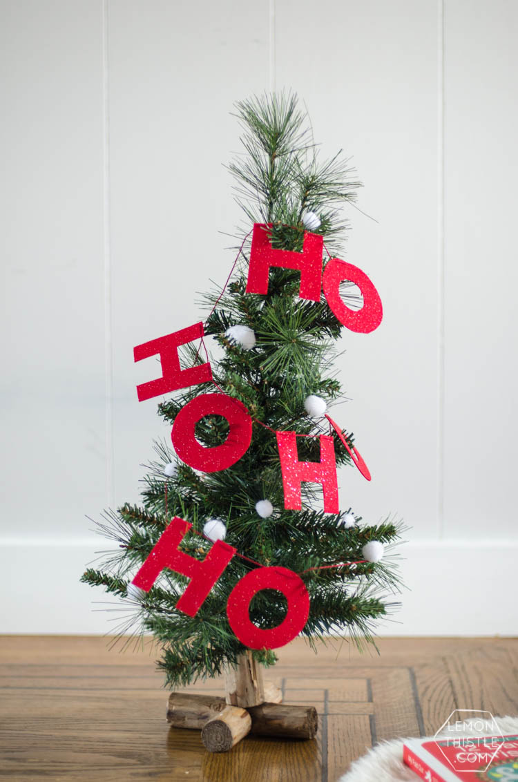 i love this diy christmas garland the modern felt letters are perfect and the