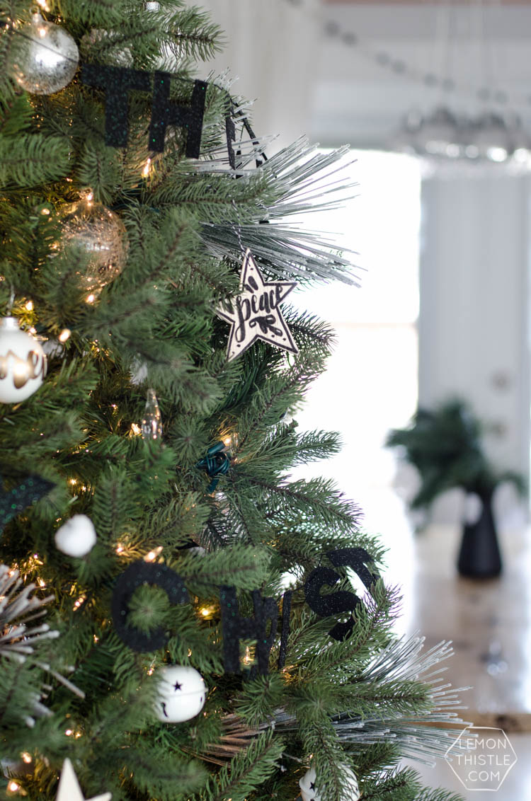 Canadian Christmas Home Tour- I love the black, white and fresh greenery in this holiday style!