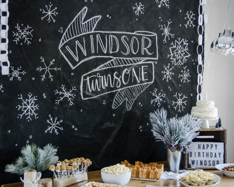 What a clever idea! Using a dropcloth to create a DIY giant chalkboard backdrop for birthday party decorations! Perfect for this modern winter wonderland!