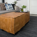 What a great way to bring a storage ottoman up to date! DIY Leather Slip Cover (from reclaimed leather)