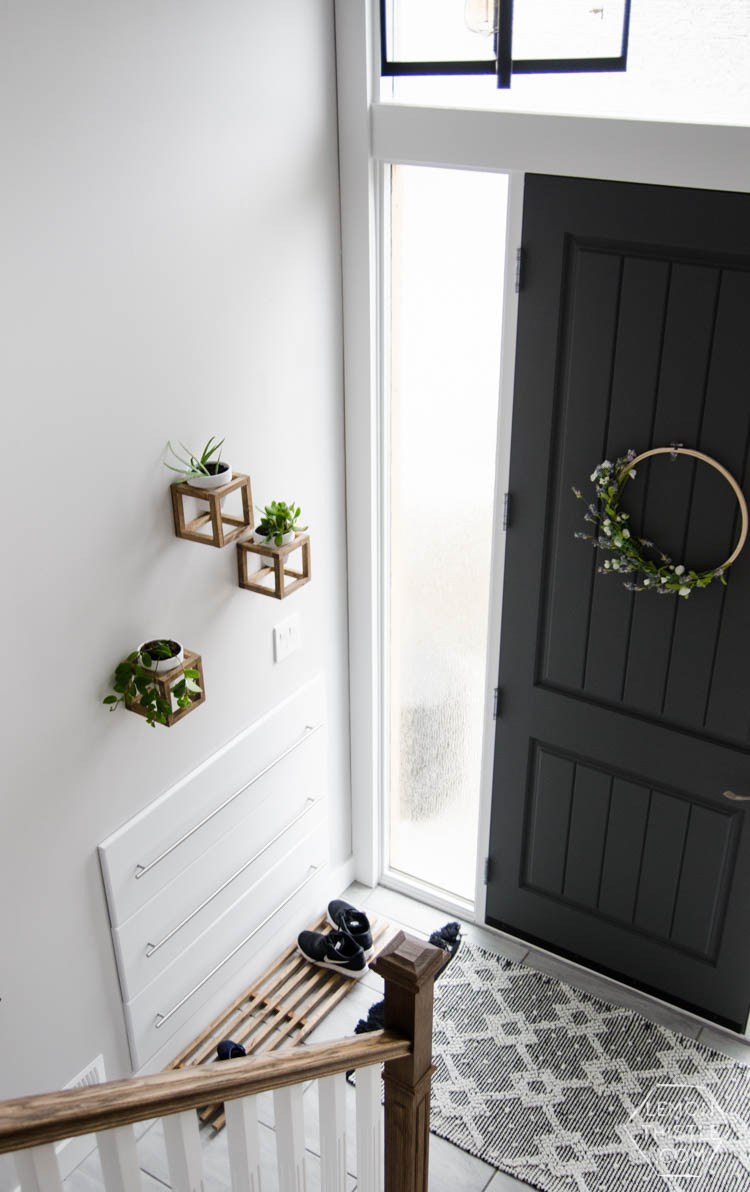 DIY Split Level Entry Makeover- I LOVE this entry. The oversize door, scandi influence and that shoe storage!