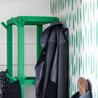 Simple Wooden DIY Coat Rack- love the bright green of this one! So great for a small space.