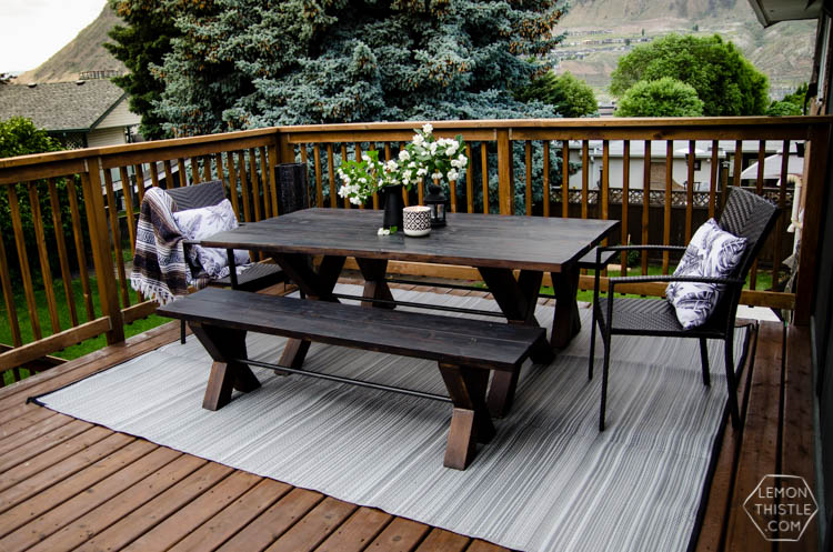 Deck reveal! I love the look of a wooden deck and the practical furniture here is awesome