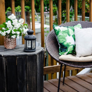 I love the wood look deck and this seating area is so sweet!