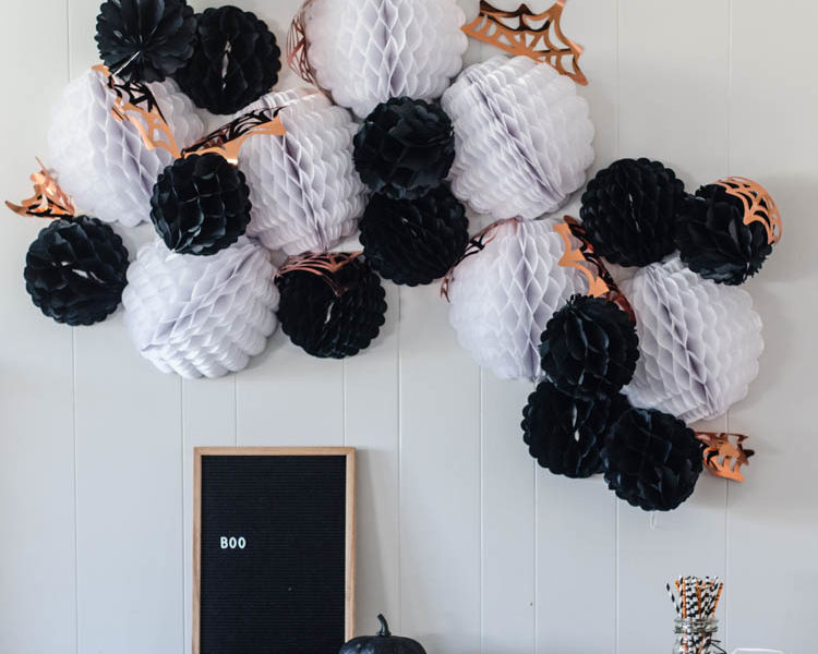 Giant DIY Halloween Party Garland with tissue honeycomb balls and party foil