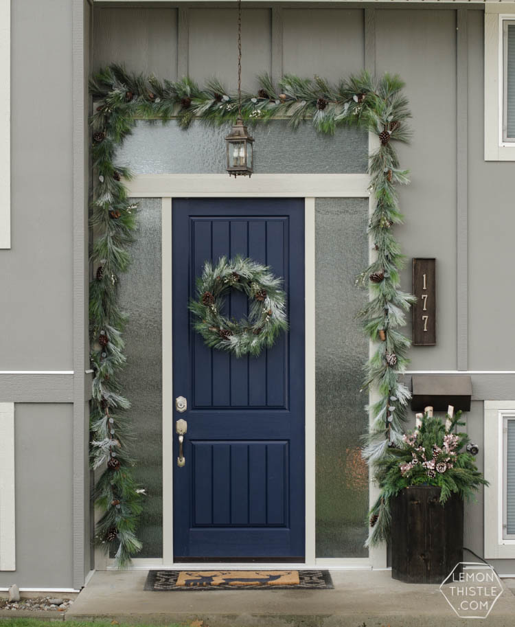 A modern holiday entry way- love the frosted greens and simple black planter- perfect for christmas