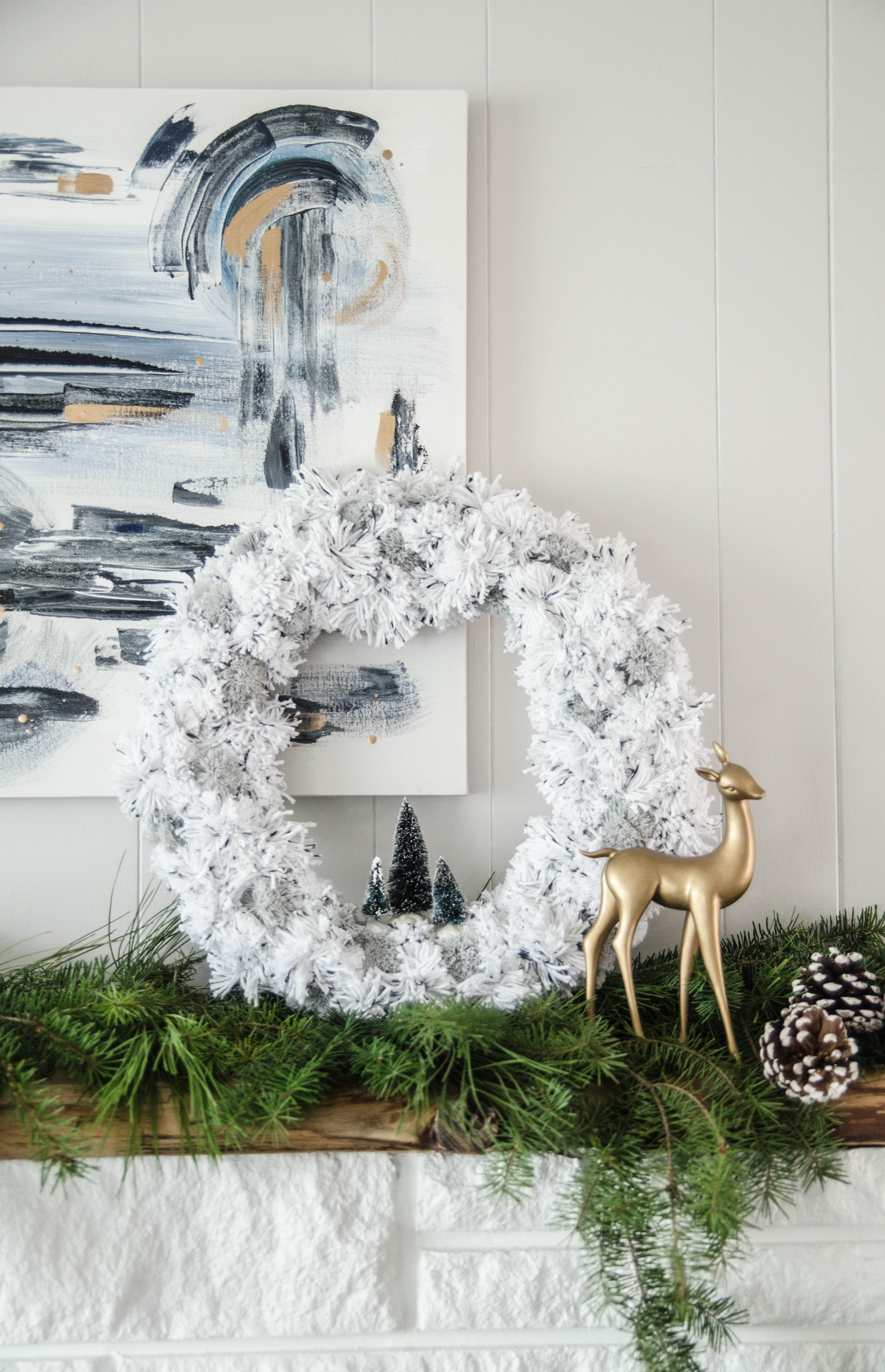 DIY Pom Pom Wreath for the holidays- love the bottle brush trees in there!
