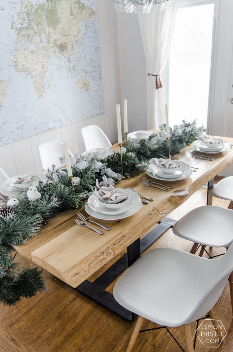 So pretty! A frosted holiday tablescape- DIY place cards and simple garland table runner... perfect for Christmas or any winter dinner party!