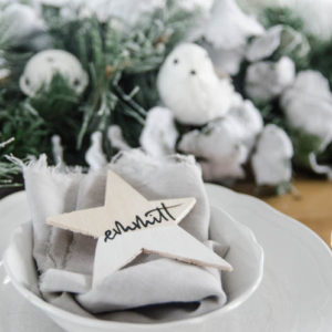 DIY Paint Dipped Wooden Star Place Cards- love that you don't need any tools to cut these wood stars! Such beautiful place settings that can be taken home as gifts after the dinner party