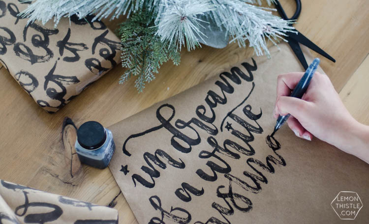 This handlettered Kraft wrapping paper is amazing! Now I want that brush so I can make some to wrap my christmas gifts