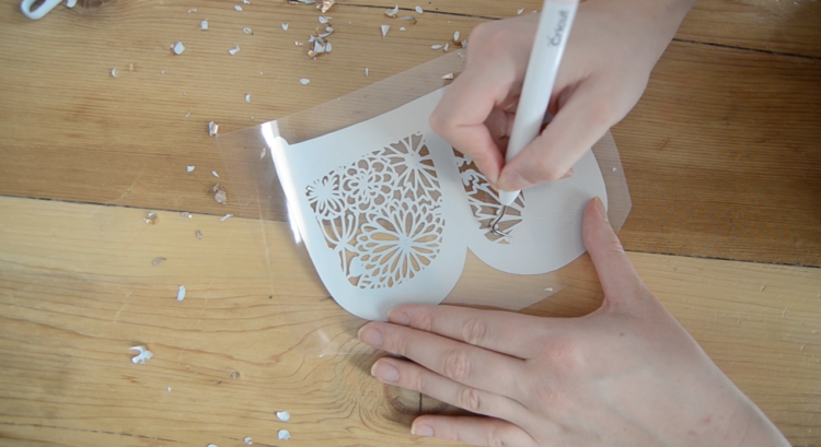 weeding floral b monogra out of foil iron on material for cricut