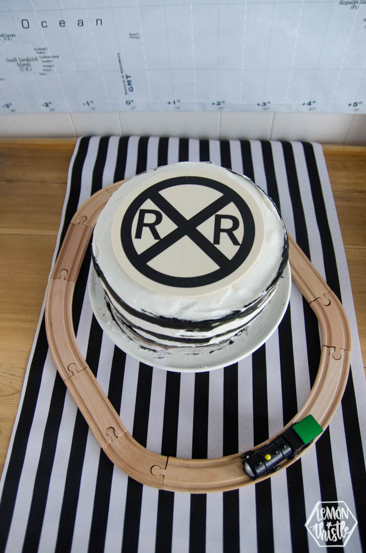 railroad cake and wooden topper made with iron on lite and a wood round