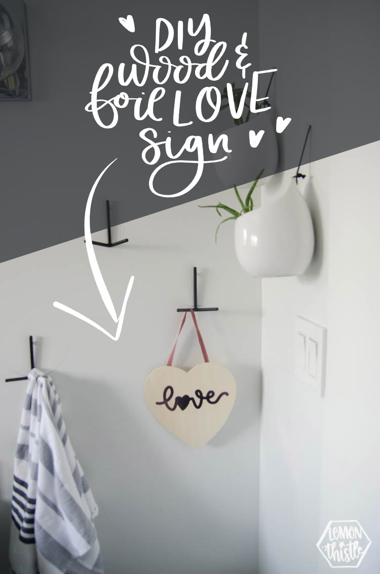 Photo of wooden heart sign with script word love in pink foil. Text ovelay: DIY Wood & Foil Love Sign