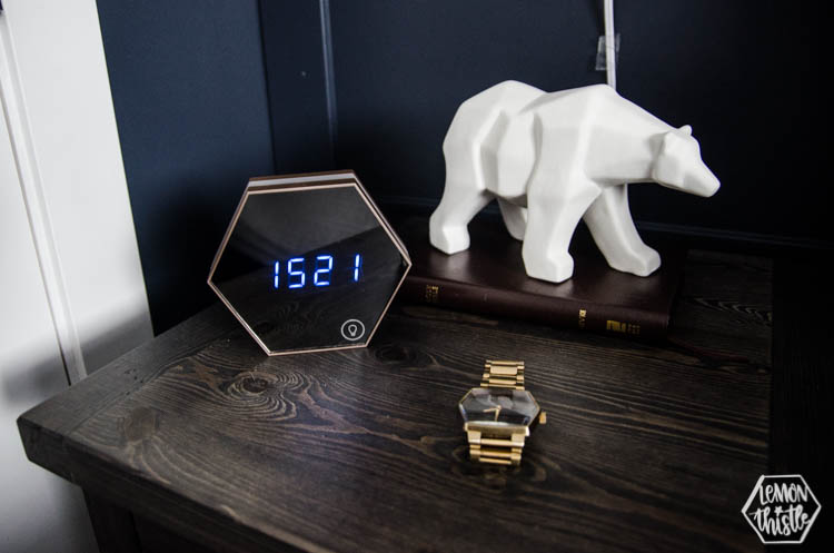 masculine details on nightstand- modern digital alarm clock