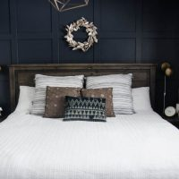 King bed with white quilted duvet cover and moulding feature wall