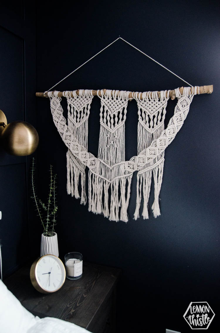 modern macrame wall hanging on navy wall