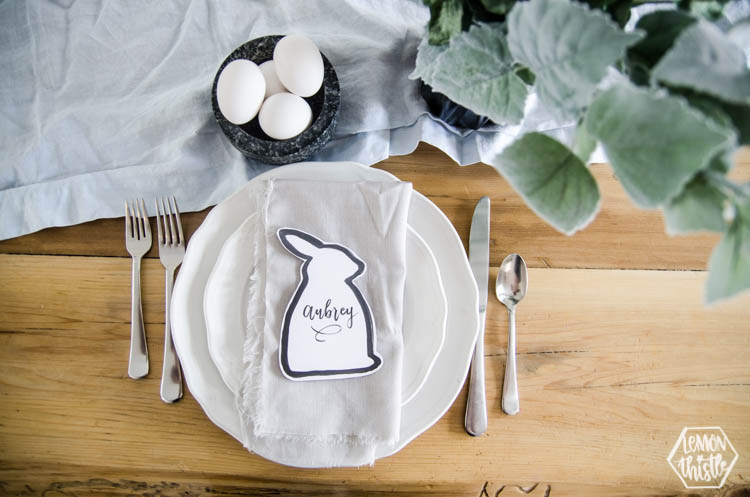 Easter bunny shaped black and white place card at natural pastel easter place setting