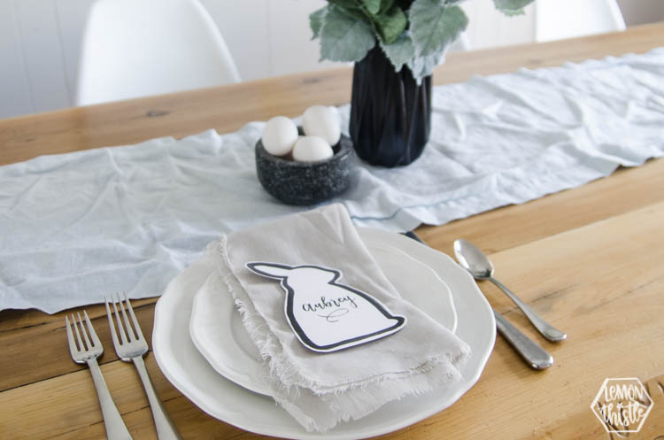 Modern and pastel easter tablescape with text overlay: DIY Simple Easter Table Setting