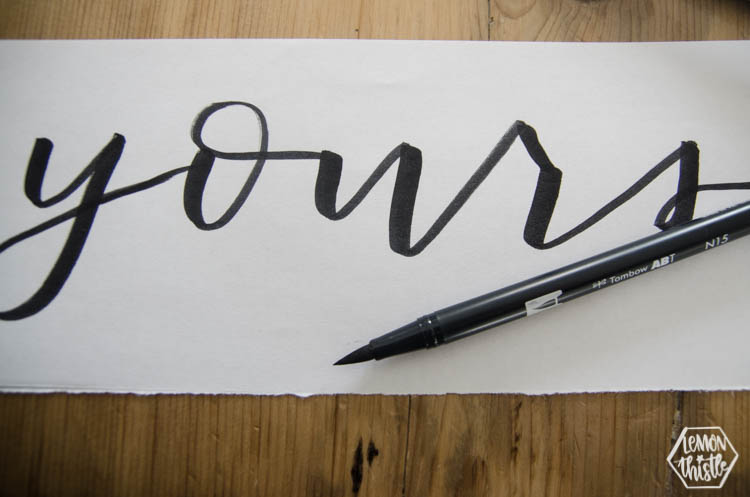 Tombow Dual Brush Pen lettered 'Yours' on white paper