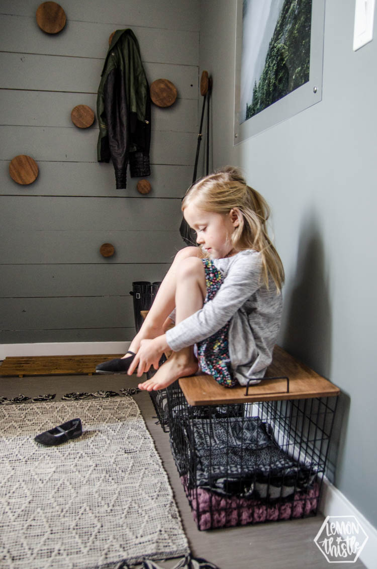 modern grey and wood DIY Mini Mudroom Makeover- showing how basket lids remove for storage, but on they are a bench for kids