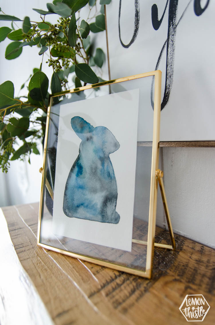 Side view of DIY modern watercolour bunny for easter in moody blues