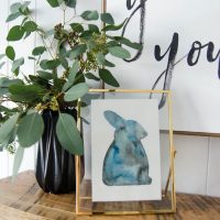 Watercolour rabbit with vase of seeded eucalyptus for spring mantel decor