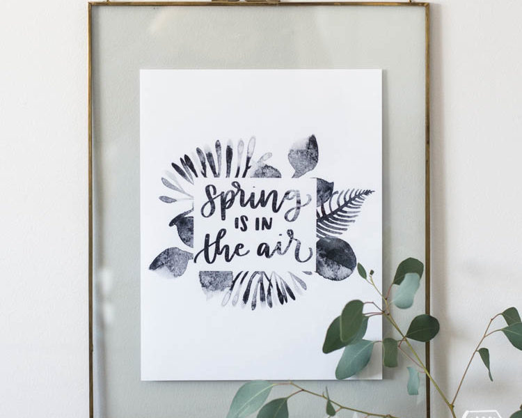 spring is in the air black watercolor printable handlettered in floating frame with vase of eucalyptus