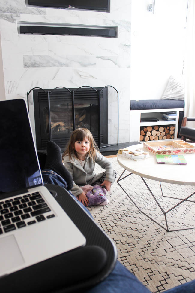 Working at laptop with kids at home