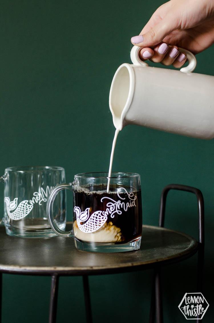 Pouring cream into coffee in clear glass DIY Mermaid Mug