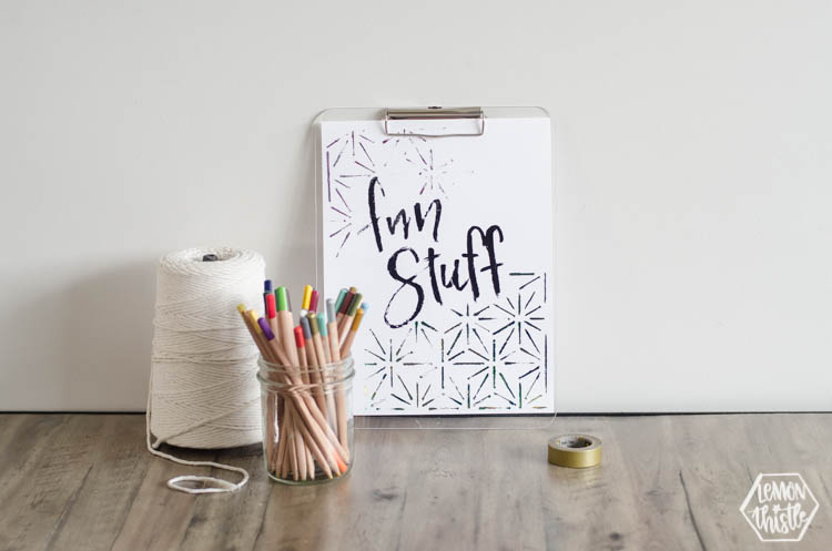 art station with macrame string, pencil crayons and clipboard with 'fun stuff' quote in black foil
