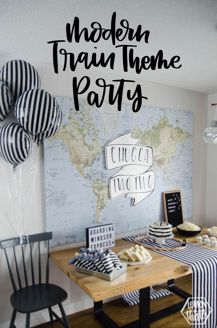 modern black and white train themed party table